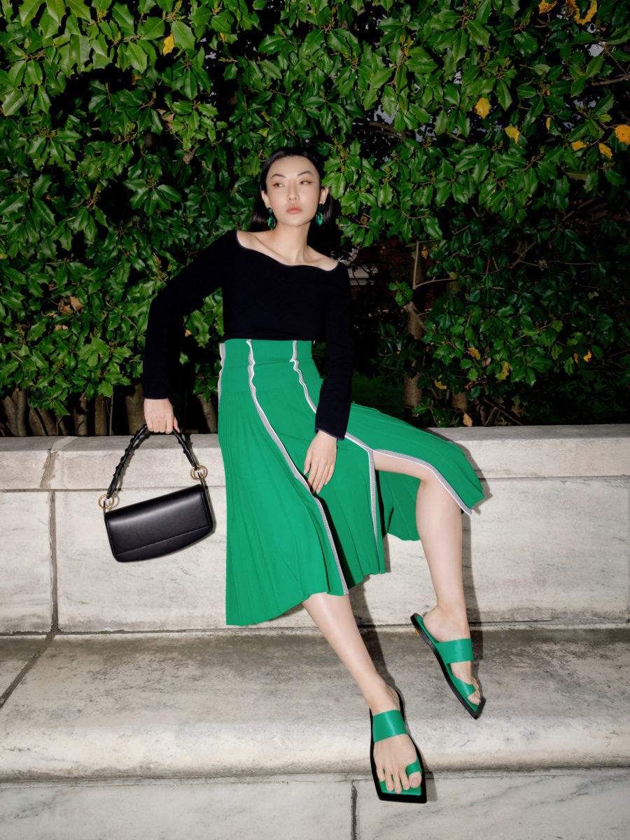jessica wang wearing a black off the shoulder top with a green pleated skirt for a back to office outfit // Jessica Wang - Notjessfashion.com