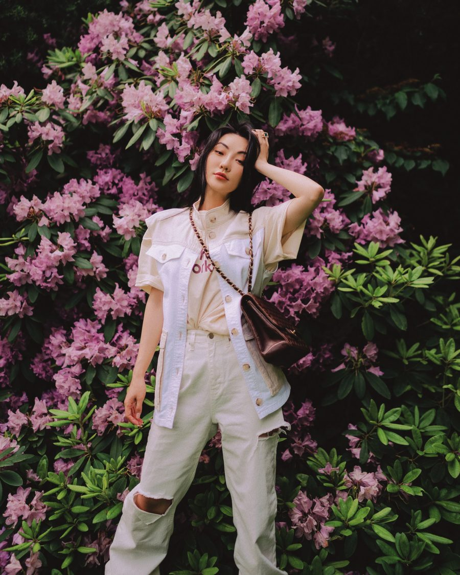Jessica Wang wearing a beige vest jacket featuring baum und pferdgarten, distressed jeans in white, and AGL cut out ankle boots with a chanel chain handbag while sharing tips on becoming an influencer in 2021 // Jessica Wang - Notjessfashion.com
