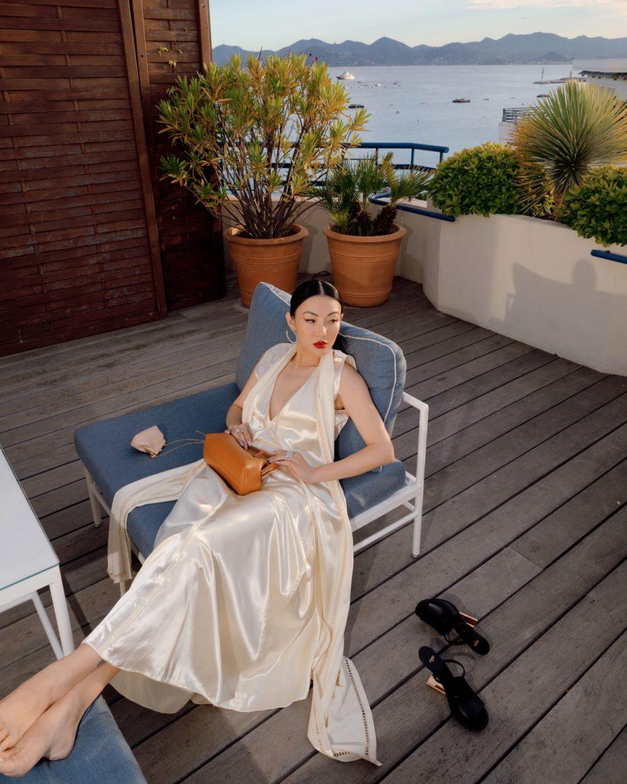 jessica wang wearing a white fendi satin dress at the cannes film festival 2021 // Jessica Wang - Notjessfashion.com