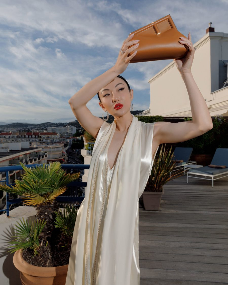 jessica wang wearing a white fendi satin dress with fendi first leather sandals and fendi first small leather bag for the cannes film festival 2021 // Jessica Wang - Notjessfashion.com