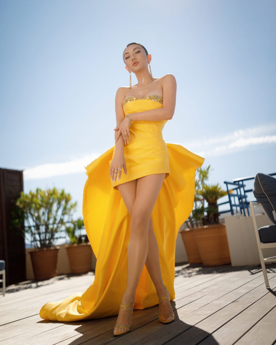 jessica wang wearing a yellow strapless bustier mini dress with a ruffle train featuring Tony Ward couture at the cannes film festival // Jessica Wang - Notjessfashion.com