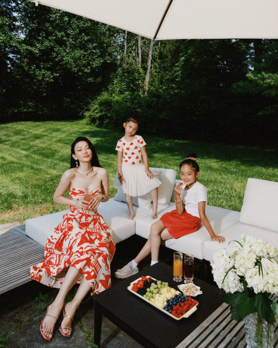 jessica wang wearing a red and white printed strapless dress while sharing the coziest airbnb rentals in upstate new york // Jessica Wang - Notjessfashion.com