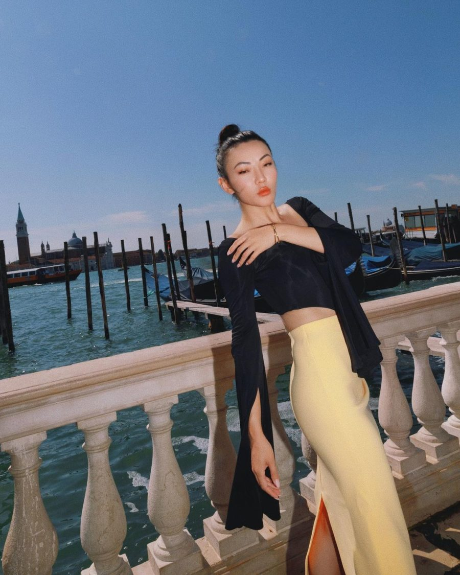 Jessica Wang wearing fall wedding guest outfits featuring a black crop top and yellow midi skirt // Jessica Wang - Notjessfashion.com