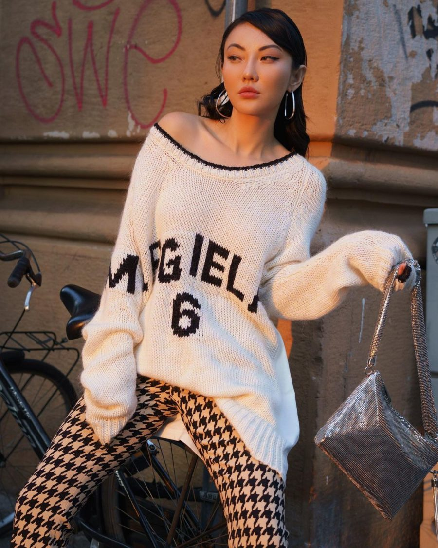 milan fall street style looks featuring Jessica Wang wearing an MM6 Maison Margiela Sweater, houndstooth pants, and Stella McCartney Platform boots with a metallic Jimmy Choo Shoulder Bag // Jessica Wang - Notjessfashion.com
