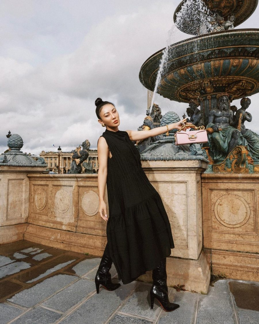 Jessica Wang wearing a black dress, patent boots with a lanvin clutch while sharing her favorite Paris Fashion Week looks // Jessica Wang - Notjessfashion.com