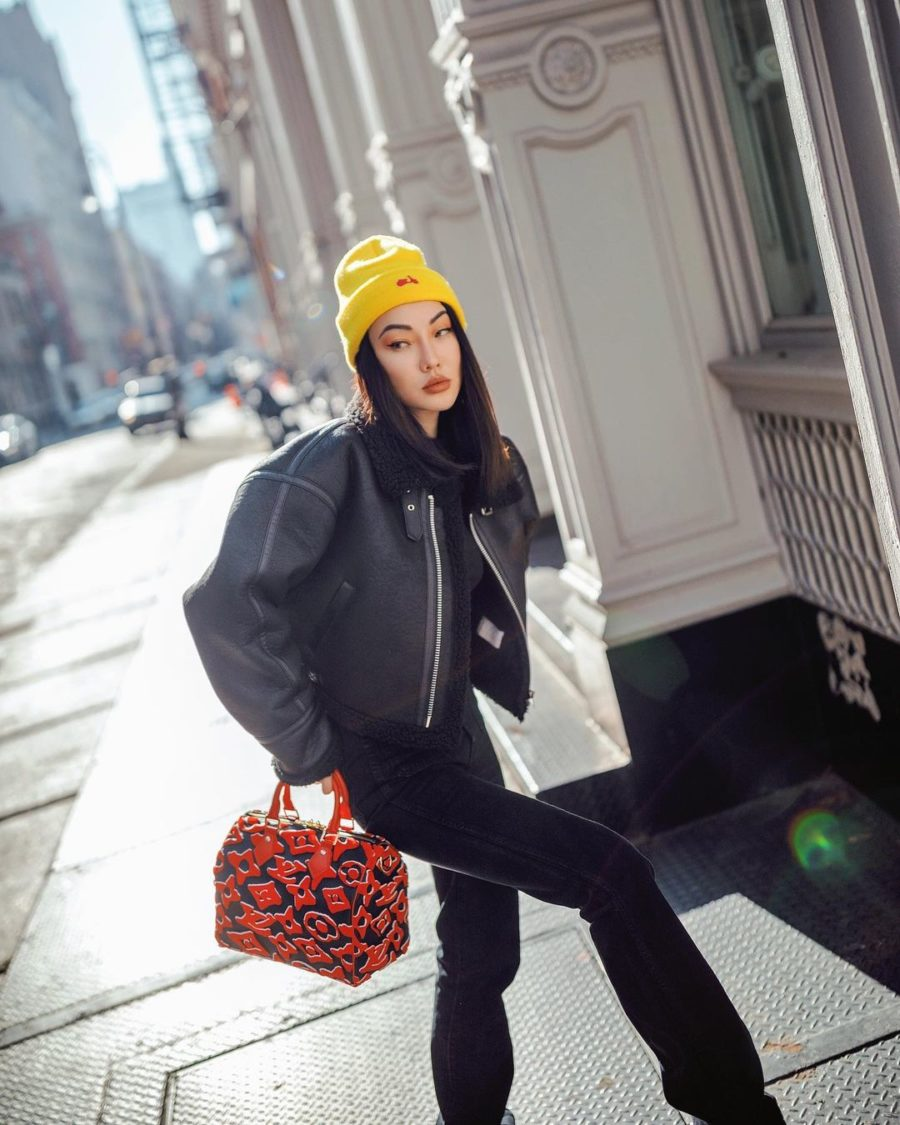 Jessica Wang wearing a cropped shearling lined leather jacket with black denim jeans and a louis vuitton bag // Jessica Wang - Notjessfashion.com