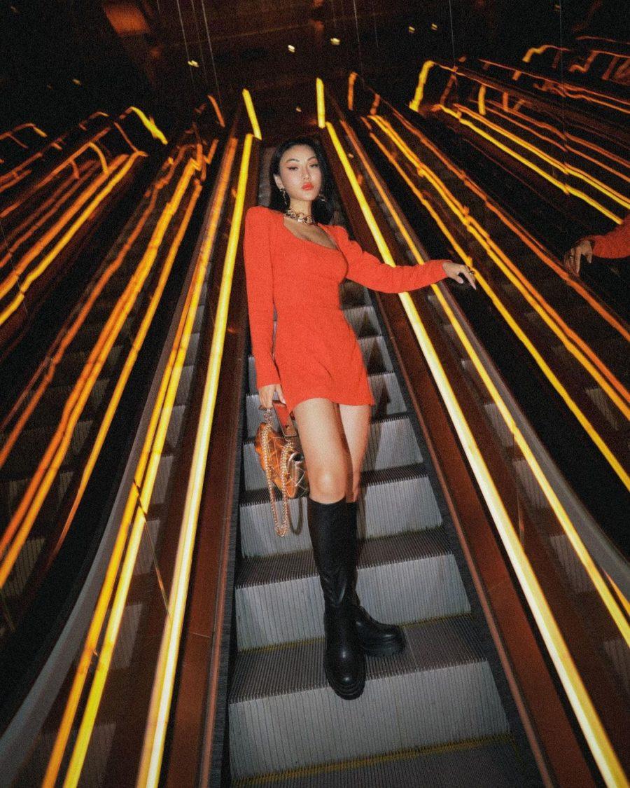 Jessica Wang wearing an orange bodycon mini dress with knee high lug sole boots // Jessica Wang - Notjessfashion.com